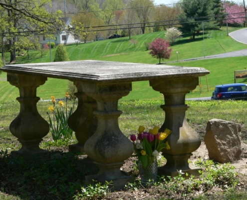 TP shows My Louisa tomb in spring with a vase of tulips and daffodils