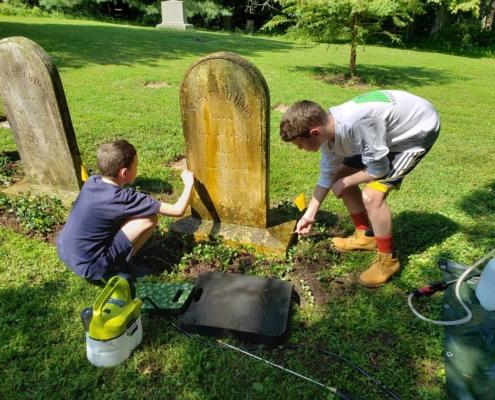 TP shows Parish children beautifying a gravesite