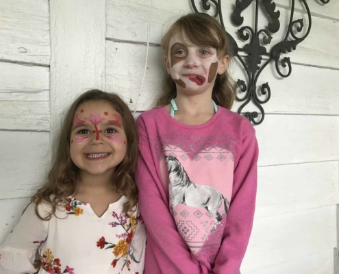 TP shows children gleefully showing off painted faces