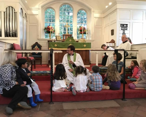 TP shows Fr. Jeff with the Children gathered for a sermon
