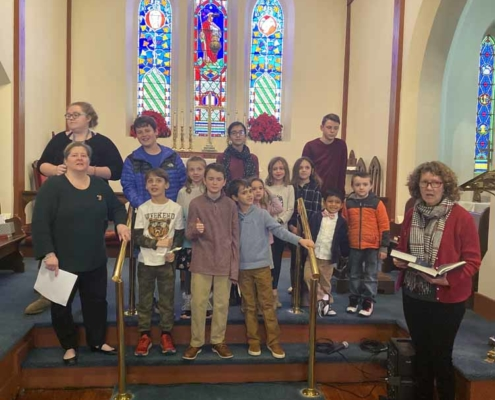TP shows children rehearsing the annual Christmas Pageant
