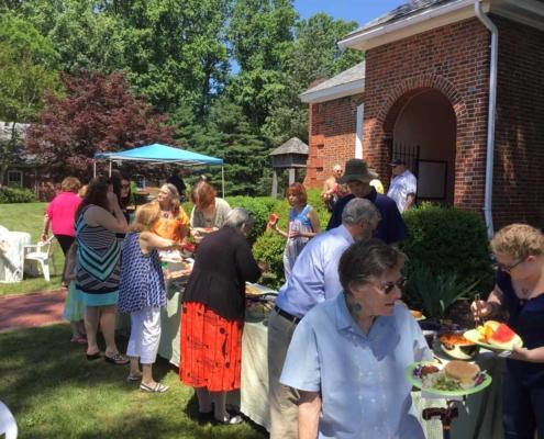 TP shows Parishioners going through pot luck line at the Annual Parish Picnic