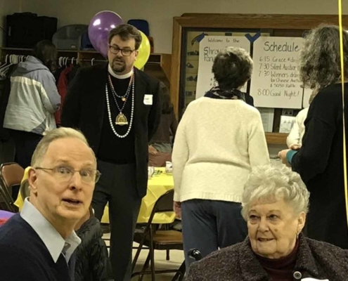 TP shows Parishioners enjoying each other's company at the Shrove Tuesday Pancake Supper