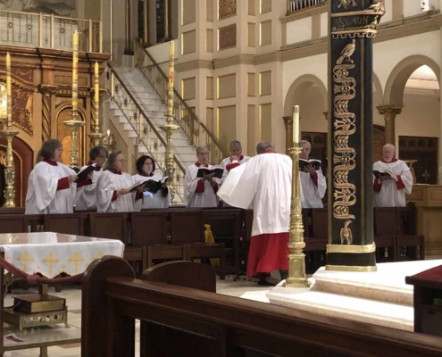 TP shows the choir singing at the Franciscan Monastery in Washington DC