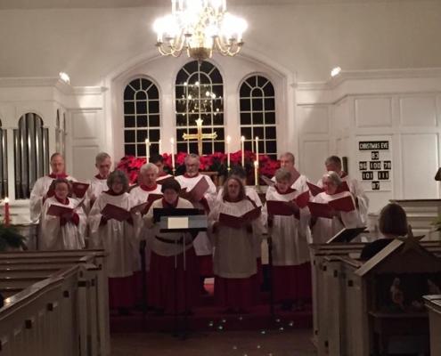 TP shows Choir singing carols on Christmas Eve
