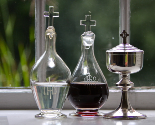 TP shows the Communion elements awaiting consecration