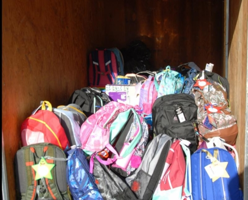 TP shows backpacks filled with school supplies for local children donated by parishioners