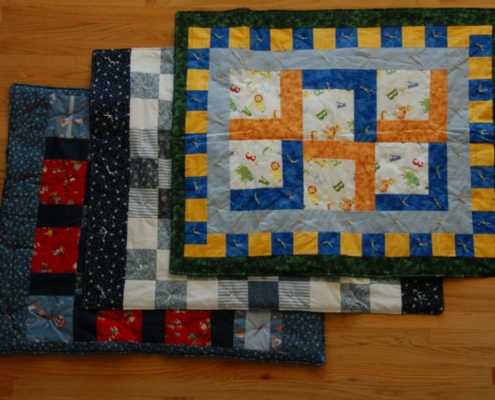 TP shows hand made quilts created by our Redeemer Quilters