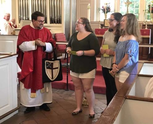 TP shows Fr. Jeff congratulating graduating high school seniors