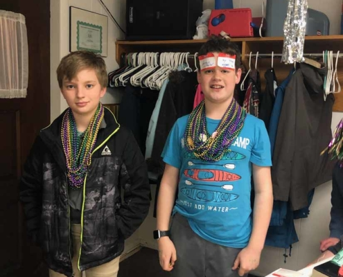 TP shows members of our Youth Group wearing Mardi Gras beads at our Shrove Tuesday Pancake Supper