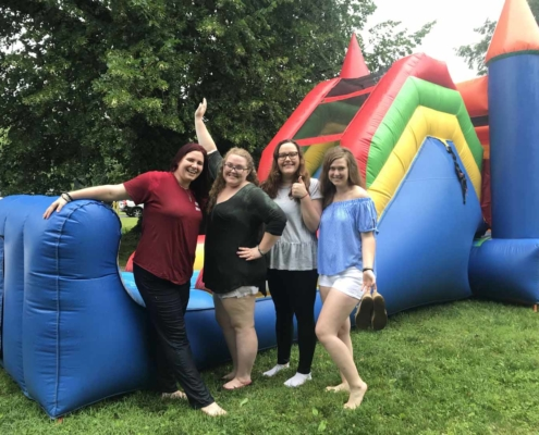 TP shows youth members at an inflatable bounce castle at a parish picnic