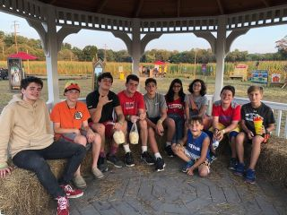 TP shows the youth group members in a gazebo at a corn maze